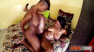 Black lesbian duo rubbing cock-squeezing pussies together